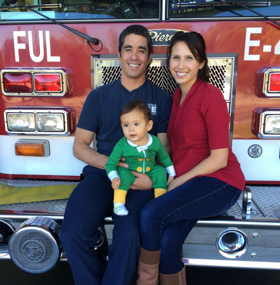 Mochizukis paid off six-figure debt in 33 months. Kyle, Lauren, Owen at the fire station.